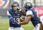 Notre Dame quarterback Ian Book (12) hands off to running back Dexter Williams (2) during the first half of an NCAA college football game against Syracuse, Saturday, Nov. 17, 2018, at Yankee Stadium in New York. (AP Photo/Howard Simmons)