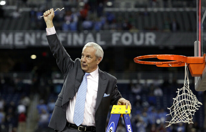 FILE - North Carolina head coach Roy Williams celebrates after his team's 89-72 victory over Michigan State in the championship game at the men's NCAA Final Four college basketball tournament in Detroit, in this Tuesday, April 7, 2009, file photo. North Carolina announced Thursday, April 1, 2021, that Hall of Fame basketball coach Roy Williams is retiring after a 33-year career that includes three national championships. (AP Photo/Paul Sancya, File)