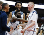 UC Irvine guard Max Hazzard (2) celebrates with forward Collin Welp, right, after Welp makes a shot and gets a foul called on Cal State Fullerton on the play during the second half of an NCAA college basketball game for the Big West men's tournament championship in Anaheim, Calif., Saturday, March 16, 2019. UC Irvine won 92-64. (AP Photo/Alex Gallardo)