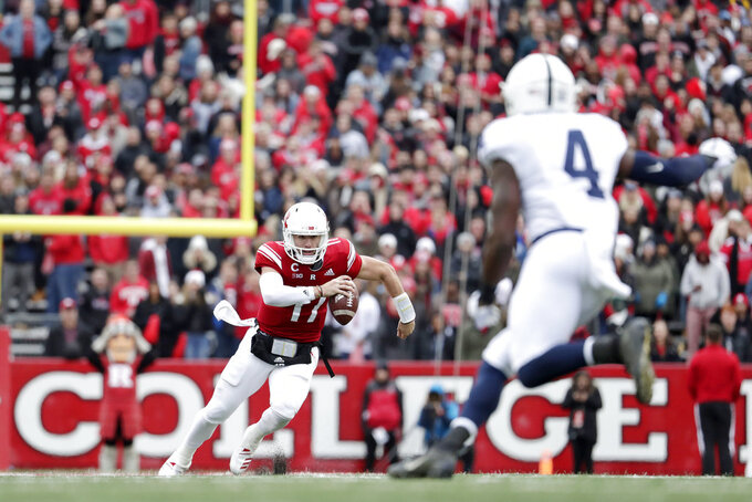 Rutgers quarterback Giovanni Rescigno (17) runs with the ball as Penn State safety Nick Scott (4) moves in during the second half of an NCAA college football game, Saturday, Nov. 17, 2018, in Piscataway, N.J. (AP Photo/Julio Cortez)