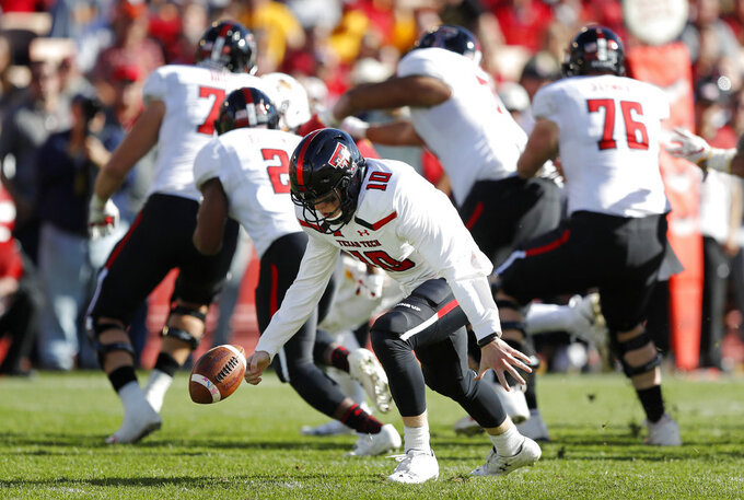 Texas Tech quarterback Alan Bowman recovers a fumbled snap during the second half of an NCAA college football game against Iowa State, Saturday, Oct. 27, 2018, in Ames, Iowa. Iowa State won 40-31. (AP Photo/Charlie Neibergall)