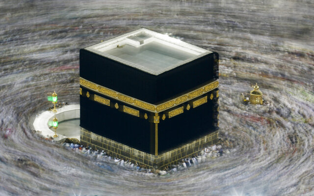 "FILE - In this Aug. 13, 2019 file photo taken with slow shutter speed, Muslim pilgrims circumambulate the Kaaba, the cubic building at the Grand Mosque, durning the hajj pilgrimage in the Muslim holy city of Mecca, Saudi Arabia. Saudi Arabia says this year's hajj will not be canceled, but that due to the coronavirus only ""very limited numbers"" of people will be allowed to perform the major Muslim pilgrimage. The kingdom said Monday, June 22, 2020 that only people of various nationalities already residing in the country would be allowed to perform the hajj.(AP Photo/Amr Nabil, File)"