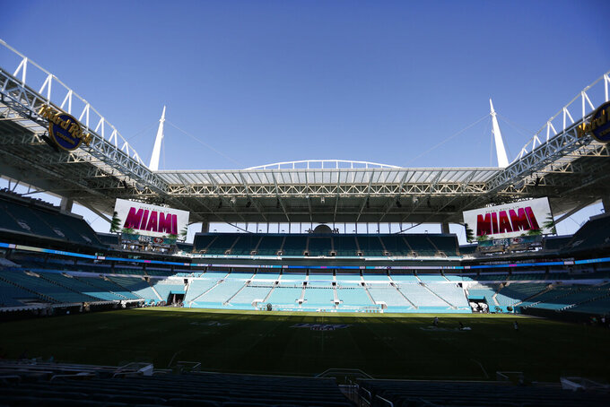 "Scoreboards display ""Super Bowl LIV Miami"" during a tour of Hard Rock Stadium on Tuesday, Jan. 21, 2020, ahead of the NFL Super Bowl LIV football game in Miami Gardens, Fla. (AP Photo/Brynn Anderson)"