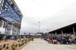 Fans watch the race on a jumbotron in the new garage and fan area during the Sugarlands Shine 250 at Talladega Superspeedway, Saturday, Oct 12, 2019, in Talladega, Ala. (AP Photo/Butch Dill)
