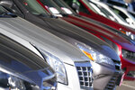 This Nov. 15, 2020 photo shows a long row of unsold used vehicles  at a Chrysler/Jeep dealership in Englewood, Colo. In 2021,  high demand and low supply have driven up used vehicle prices so much that many are now selling for more than their original sticker price when they were new.   (AP Photo/David Zalubowski)