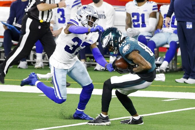 Philadelphia Eagles wide receiver Quez Watkins (80) catches a long pass as Dallas Cowboys safety Donovan Wilson (37) defends in the second half of an NFL football game in Arlington, Texas, Sunday, Dec. 27. 2020. (AP Photo/Michael Ainsworth)