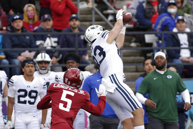 BYU tight end Isaac Rex, right, catches a pass in front of Washington State defensive back Derrick Langford during the first half of an NCAA college football game, Saturday, Oct. 23, 2021, in Pullman, Wash. (AP Photo/Young Kwak)