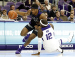 Kansas State forward Xavier Sneed (20) drives to the basket as TCU forward Kouat Noi (12) loses his footing defending in the first half of an NCAA college basketball game in Fort Worth, Texas, Monday, March 4, 2019. (AP Photo/Tony Gutierrez)