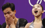 Ryom Tae Ok and Kim Ju Sik of North Korea react after their scores are posted following their performance in the pair figure skating short program in the Gangneung Ice Arena at the 2018 Winter Olympics in Gangneung, South Korea, Wednesday, Feb. 14, 2018. (AP Photo/Bernat Armangue)
