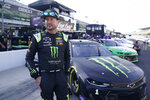 Kurt Busch walks in the pits before qualifications for the NASCAR Series auto race at Indianapolis Motor Speedway, Sunday, Aug. 15, 2021, in Indianapolis. (AP Photo/Darron Cummings)