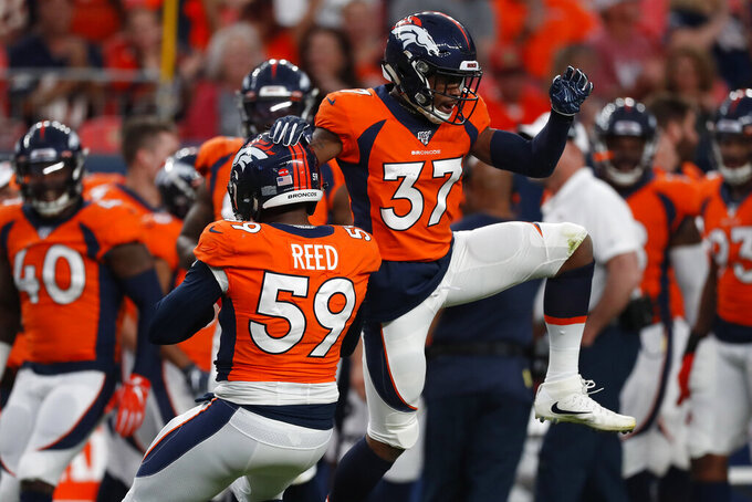 Denver Broncos linebacker Malik Reed (59) celebrates his sack against the Arizona Cardinals with cornerback Linden Stephens (37) during the first half of an NFL preseason football game, Thursday, Aug. 29, 2019, in Denver. (AP Photo/David Zalubowski)