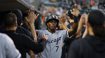 Chicago White Sox's Tim Anderson (7) celebrates scoring against the Detroit Tigers in the third inning of a baseball game in Detroit, Monday, Sept. 20, 2021. (AP Photo/Paul Sancya)
