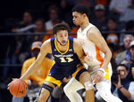Chattanooga forward Rod Johnson (11) works the ball against Tennessee forward Olivier Nkamhoua (21) during the second half of an NCAA college basketball game Monday, Nov. 25, 2019, in Knoxville, Tenn. (AP Photo/Wade Payne)