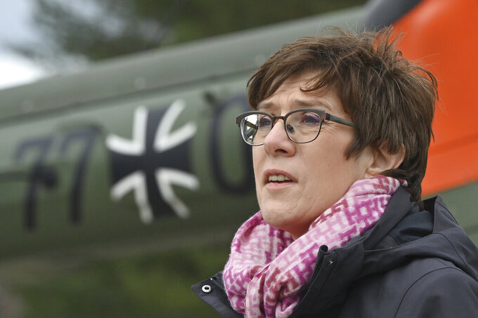 FILE - In this April 12, 2021 file photo, Annegret Kramp-Karrenbauer, Federal Minister of Defence, speaks at Holzdorf Air Base in Schoenewalde, Germany. The German defense minister says she wants to help bring potentially endangered Afghan employees of her country's military to Germany as it prepares to leave Afghanistan after nearly 20 years. (Patrick Pleul/dpa via AP, File)
