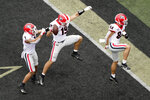 Georgia tight end Brock Bowers (19) celebrates with Jermaine Burton (7) and Ladd McConkey (84) after Bowers scored his second touchdown of the game against Vanderbilt in the first half of an NCAA college football game Saturday, Sept. 25, 2021, in Nashville, Tenn. (AP Photo/Mark Humphrey)