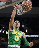 Boston Celtics' Jayson Tatum dunks during the first half of an NBA basketball game against the San Antonio Spurs, Monday, Dec. 31, 2018, in San Antonio. (AP Photo/Darren Abate)