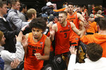 Oregon State's Ethan Thompson (5), Tres Tinkle (3) and Roman Silva celebrate their 82-65 win over Arizona with fans after an NCAA college basketball game in Corvallis, Ore., Sunday, Jan. 12, 2020. (AP Photo/Chris Pietsch)