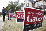 In this January 11, 2020 photoGary Gates, a Republican businessman running for a Texas state house seat up for special election in the suburbs west of Houston speaks in front of campaign signs placed on a volunteers lawn in Katy, Texas. Gates' opponent, Eliz Markowitz, is getting national endorsements from big name Democrats before voters go the polls on January 28. (AP Photo/ John L. Mone)