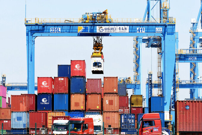 A gantry crane moves containers at a port in Qingdao in eastern China's Shandong province Friday, June 4, 2021. China's exports surged nearly 28% in May while imports jumped 51% as demand rebounded in the U.S. and other markets where the pandemic is waning, though growth is leveling off after a stunning recovery from last year's slump. (Chinatopix via AP) CHINA OUT