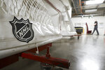 FILE - In this March 12, 2020, file photo, goals used by the NHL hockey club Nashville Predators are stored in a hallway in Bridgestone Arena in Nashville, Tenn. The Ottawa Senators announced late Tuesday night, March 17, 2020, one of their players has tested positive for COVID-19, has mild symptoms and is in isolation. (AP Photo/Mark Humphrey, File)