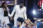 Duke's Zion Williamson greets fans as he is introduced during the NBA basketball draft Thursday, June 20, 2019, in New York. (AP Photo/Julio Cortez)