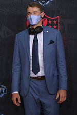 Alabama quarterback Mac Jones appears on the red carpet at the Rock & Roll Hall of Fame before the NFL football draft, Thursday, April 29, 2021, in Cleveland. (AP Photo/David Dermer, Pool)