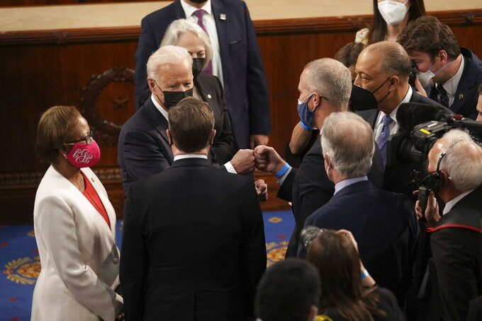 President Joe Biden greets members of congress after speaking to a joint session of Congress Wednesday, April 28, 2021, in the House Chamber at the U.S. Capitol in Washington. (Doug Mills/The New York Times via AP, Pool)