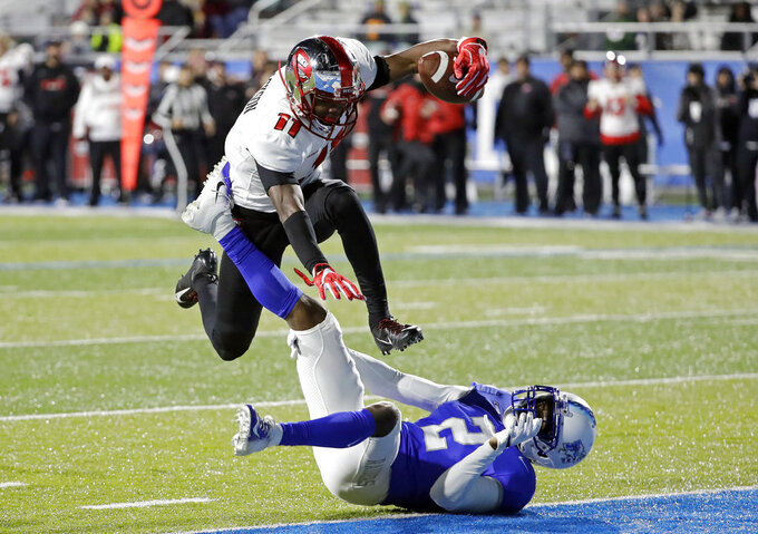 Western Kentucky wide receiver Lucky Jackson (11) leaps over Middle Tennessee defensive back Chris Stamps (2) as Jackson scores a touchdown on a 46-yard reception during the second half of an NCAA college football game Friday, Nov. 2, 2018, in Murfreesboro, Tenn. Middle Tennessee won 29-10. (AP Photo/Mark Humphrey)