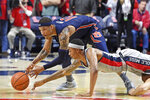 Auburn guard Samir Doughty (10) and Mississippi guard Austin Crowley dive for the ball during the second half of an NCAA college basketball game in Oxford, Miss., Tuesday, Jan. 28, 2020. Auburn won 83-82. (AP Photo/Thomas Graning)