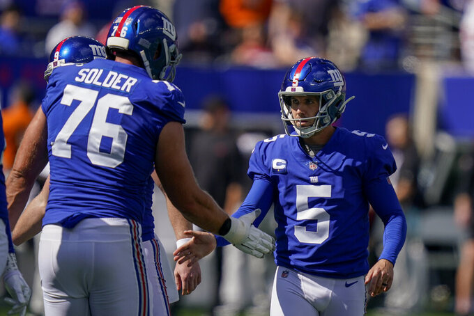 New York Giants kicker Graham Gano (5) celebrates with offensive tackle Nate Solder (76) after kicking a field goal during the first half of an NFL football game against the Atlanta Falcons, Sunday, Sept. 26, 2021, in East Rutherford, N.J. (AP Photo/Seth Wenig)