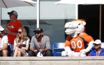 Joining fans, Denver Broncos' mascot Miles sits and watches as players take part in drills during an NFL football training camp session Monday, Aug. 5, 2019, in Englewood, Colo. (AP Photo/David Zalubowski)