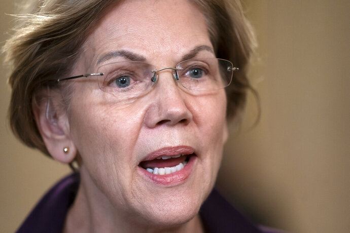 Sen. Elizabeth Warren, D-Mass., speaks during a television news interview during a break in the impeachment trial of President Donald Trump on charges of abuse of power and obstruction of Congress, at the Capitol in Washington, Monday, Jan. 27, 2020. (AP Photo/J. Scott Applewhite)