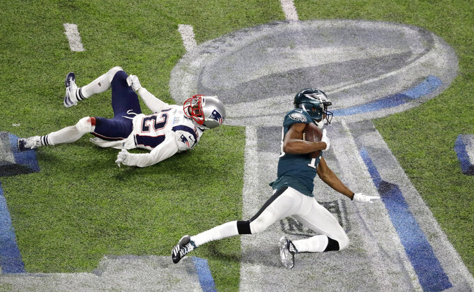 FILE - In this Feb. 4, 2018, file photo, Philadelphia Eagles wide receiver Nelson Agholor, right, catches a pass next to New England Patriots free safety Devin McCourty during the second half of the NFL Super Bowl 52 football game in Minneapolis. The Eagles return to Minnesota this week for their first game there since winning the Super Bowl almost two years ago. (AP Photo/Eric Gay, File)