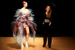 Dutch designer Iris Van Herpen, right, acknowledges audience applause after the presentation of her Haute Couture Spring/Summer 2020 fashion collection Monday Jan.20, 2020 in Paris (AP Photo/Michel Euler)