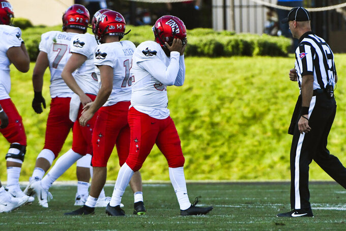 UNLV place kicker Daniel Gutierrez, center, reacts after missing a field goal against Northwestern during the second half of an NCAA college football game, Saturday, Sept. 14, 2019, in Evanston, Ill. (AP Photo/Matt Marton)