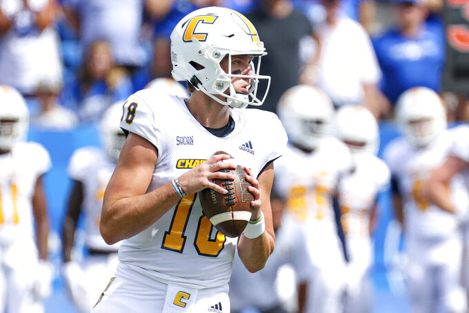 Chattanooga quarterback Cole Copeland (18) looks for an open receiver during the first half of a NCAA college football game against Kentucky in Lexington, Ky., Saturday, Sept. 18, 2021. (AP Photo/Michael Clubb)