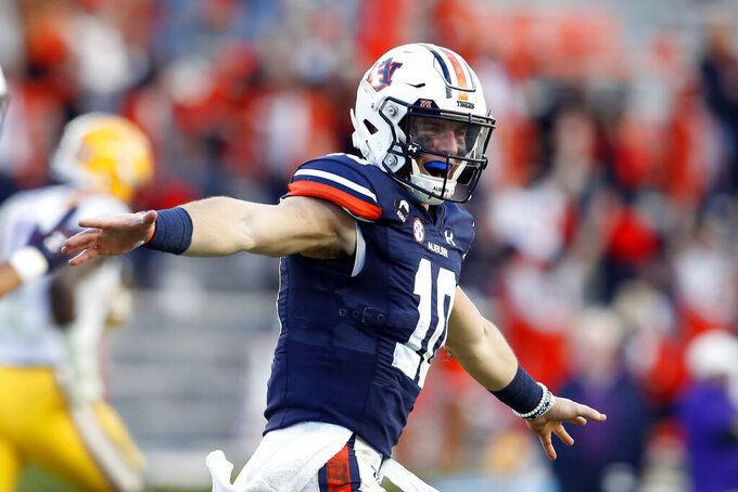Auburn quarterback Bo Nix celebrates after throwing a touchdown pass during the second half of the team's NCAA college football game against LSU on Saturday, Oct. 31, 2020, in Auburn, Ala. (AP Photo/Butch Dill)
