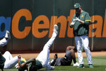 Oakland Athletics pitching coach Scott Emerson, right, talks to players during a baseball practice in Oakland, Calif., Saturday, July 4, 2020. (AP Photo/Jeff Chiu)
