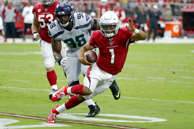 Arizona Cardinals quarterback Kyler Murray (1) scrambles as Seattle Seahawks defensive end Rasheem Green (98) pursues during the first half of an NFL football game, Sunday, Sept. 29, 2019, in Glendale, Ariz. (AP Photo/Rick Scuteri)