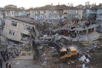 Rescuers work on searching for people buried under the rubble on a collapsed building, after an earthquake struck Elazig, eastern Turkey, Saturday, Jan. 25, 2020. Rescue workers were continuing to search for people buried under the rubble of apartment blocks in Elazig and neighbouring Malatya. Mosques, schools, sports halls and student dormitories were opened for hundreds who left their homes after the quake.(Can Celik/DHA via AP)