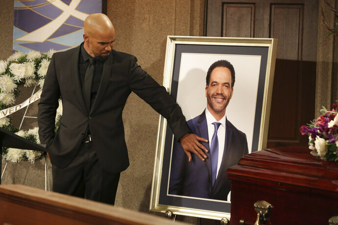 CORRECTS CHARACTER NAME FROM MORGAN TO WINTERS - This image released by CBS shows Shemar Moore portraying Malcolm Winters during a funeral scene for the character Neil Winters, portrayed by the late actor Kristoff St. John, in the daytime series