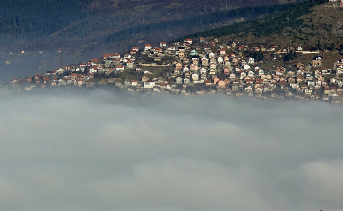 The Bosnian capital of Sarajevo is covered by layers of fog, Bosnia, Thursday, Dec. 17, 2020. With the arrival of cold and foggy winter weather, eastern Europe is facing another health hazard in addition to the new coronavirus pandemic _ dangerous air pollution. (AP Photo/Eldar Emric)
