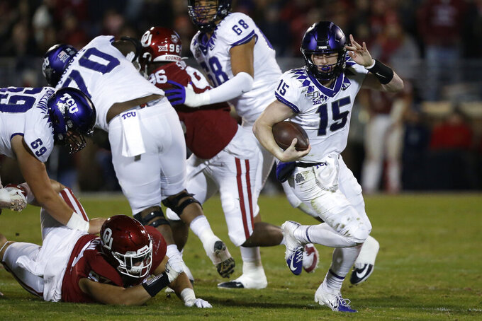 TCU quarterback Max Duggan (15) carries in the first half of an NCAA college football game against Oklahoma in Norman, Okla., Saturday, Nov. 23, 2019. (AP Photo/Sue Ogrocki)