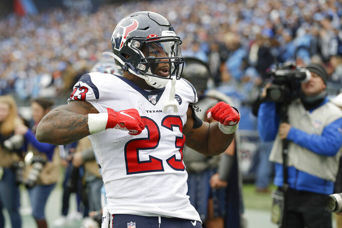 Houston Texans running back Carlos Hyde (23) celebrates after scoring a touchdown on a 10-yard run against the Tennessee Titans in the second half of an NFL football game Sunday, Dec. 15, 2019, in Nashville, Tenn. (AP Photo/James Kenney)