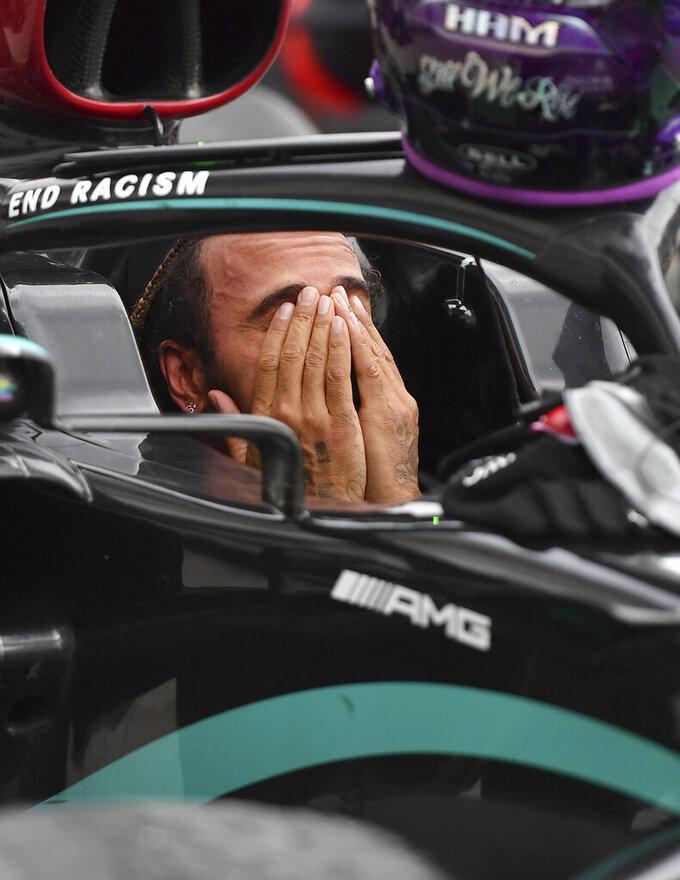 Mercedes driver Lewis Hamilton of Britain reacts in his car after winning the Hungarian Formula One Grand Prix at the Hungaroring racetrack in Mogyorod, Hungary, Sunday, July 19, 2020. (Joe Klamar/Pool via AP)