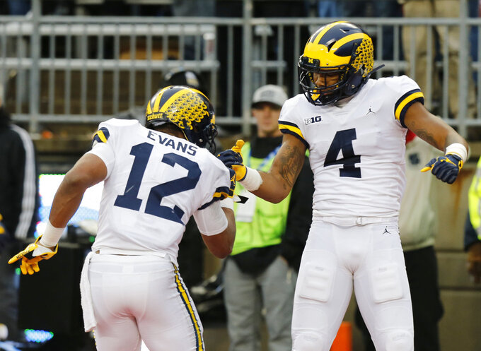 Michigan running back Chris Evans, left, and receiver Nico Collins celebrate a touchdown against Ohio State during the first half of an NCAA college football game Saturday, Nov. 24, 2018, in Columbus, Ohio. (AP Photo/Jay LaPrete)