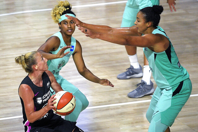 Chicago Sky guard Courtney Vandersloot, left, drives to the basket in front of New York Liberty center Kiah Stokes, right, and guard Paris Kea during the second half of a WNBA basketball game, Tuesday, Aug. 25, 2020, in Bradenton, Fla. (AP Photo/Phelan M. Ebenhack)