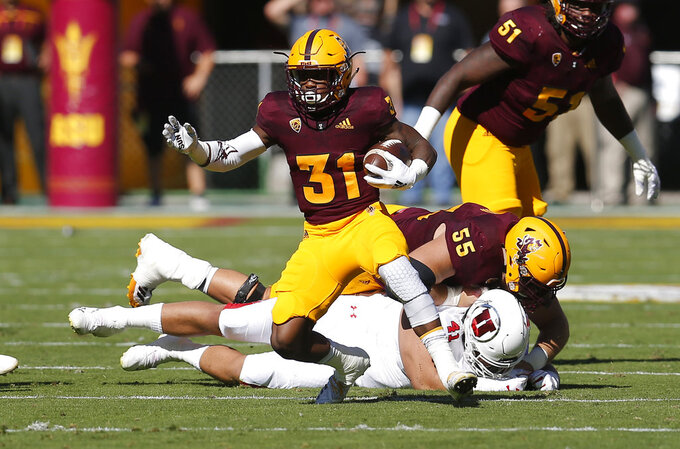 Arizona State running back Isaiah Floyd (31) runs the ball for a first down against Utah in the first half during an NCAA college football game, Saturday, Nov. 3, 2018, in Tempe, Ariz. (AP Photo/Rick Scuteri)