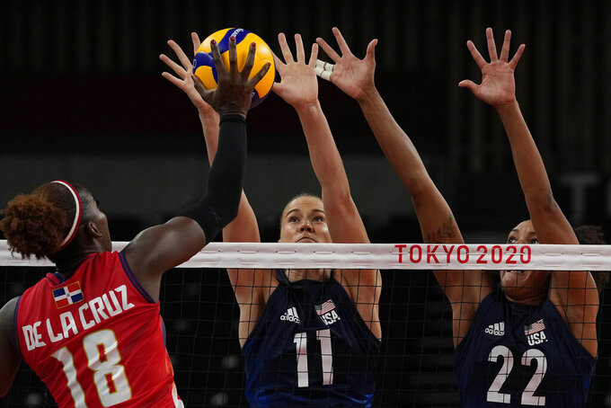 Dominican Republic's Bethania de la Cruz de Pena, from left, United States' Andrea Drews and United States' Haleigh Washington challenge for the ball during the women's volleyball quarterfinal match between Dominican Republic and United States at the 2020 Summer Olympics, Wednesday, Aug. 4, 2021, in Tokyo, Japan. (AP Photo/Frank Augstein)