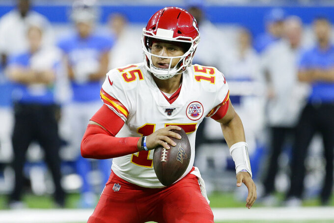 Kansas City Chiefs quarterback Patrick Mahomes scrambles during the first half of an NFL football game against the Detroit Lions, Sunday, Sept. 29, 2019, in Detroit. (AP Photo/Duane Burleson)